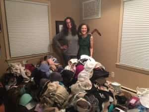 Carol Preston and Dana Marlowe with a huge pile of donations at Carol's party
